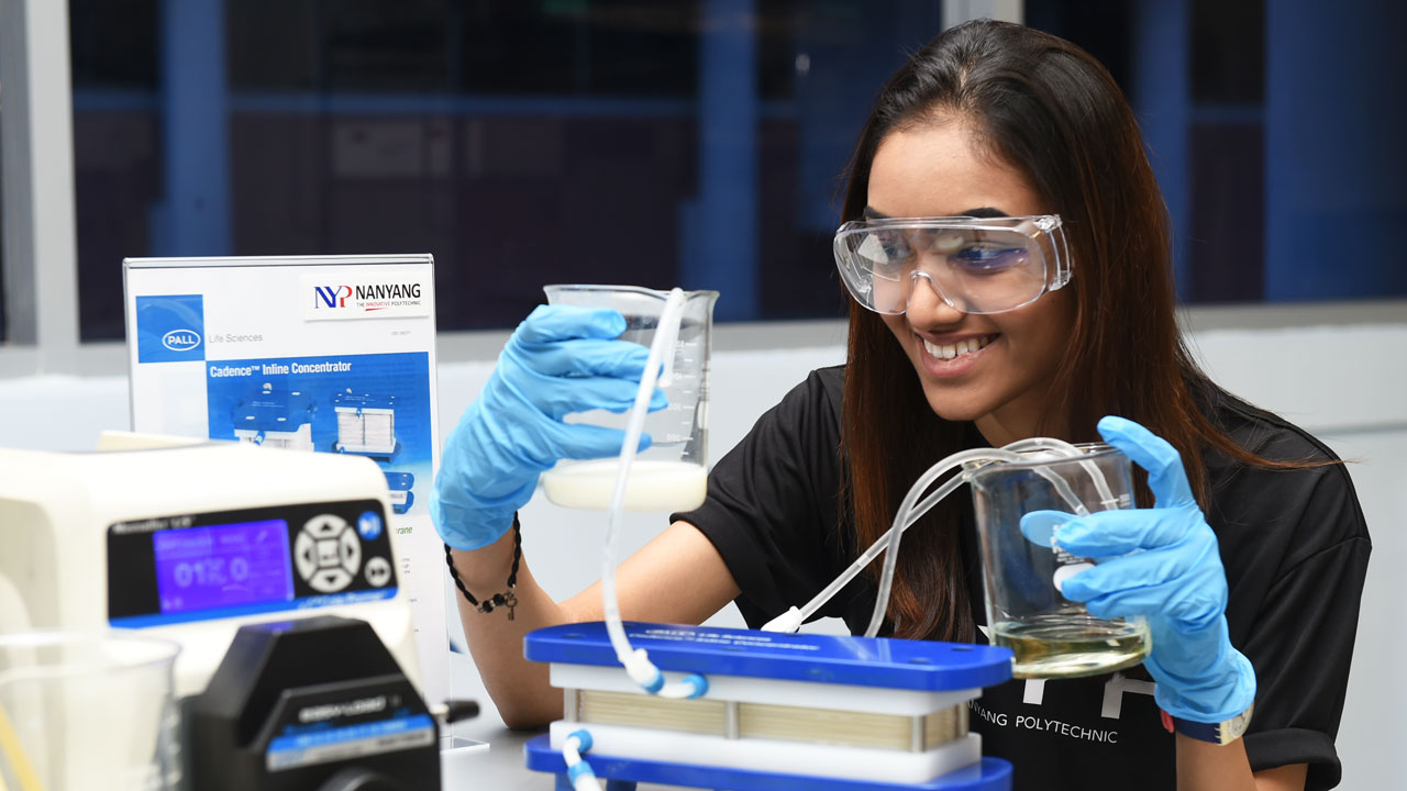 Diploma in Biologics & Process Technology student, Kajol Ramsingasan, using the latest single-use   technology at the NYP-Pall Centre of Excellence in Biologics Manufacturing Technologies.