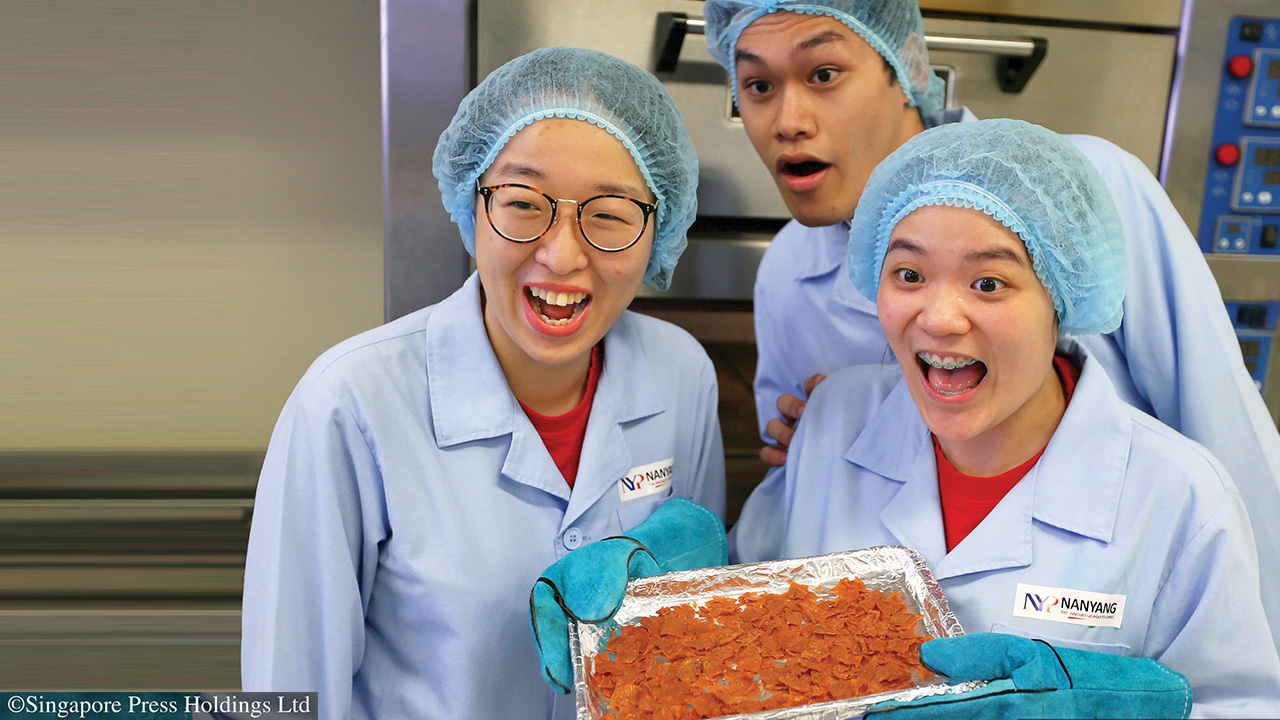 SCL students Lai Xue Er and Danice Peh from SCL (extreme left and right) created the interesting chicken and plant-based bak kwa, under the supervision of lecturer Lina Tan. SBM student Muhd Haziq (middle) helped market this food innovation. Photo source The Straits Times @ Singapore Press Holdings Limited. Permission required for reproduction.